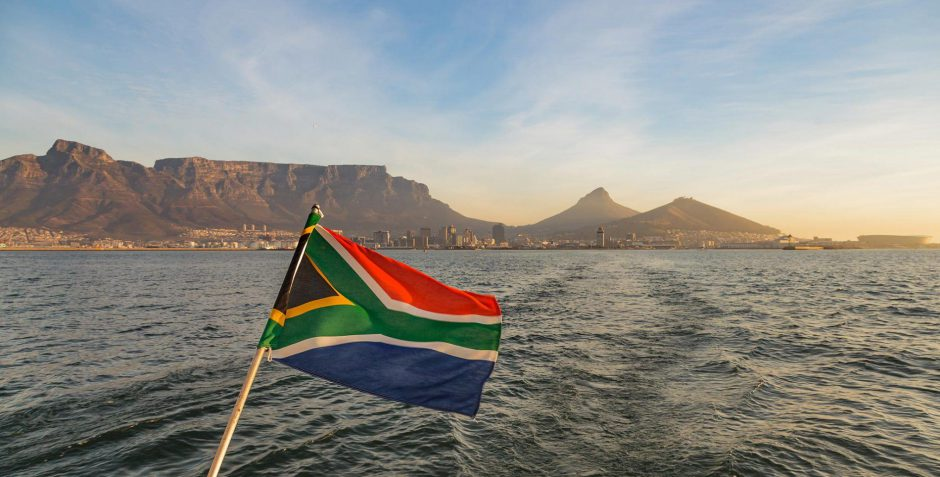 South African Flag waving in front of Table Mountain